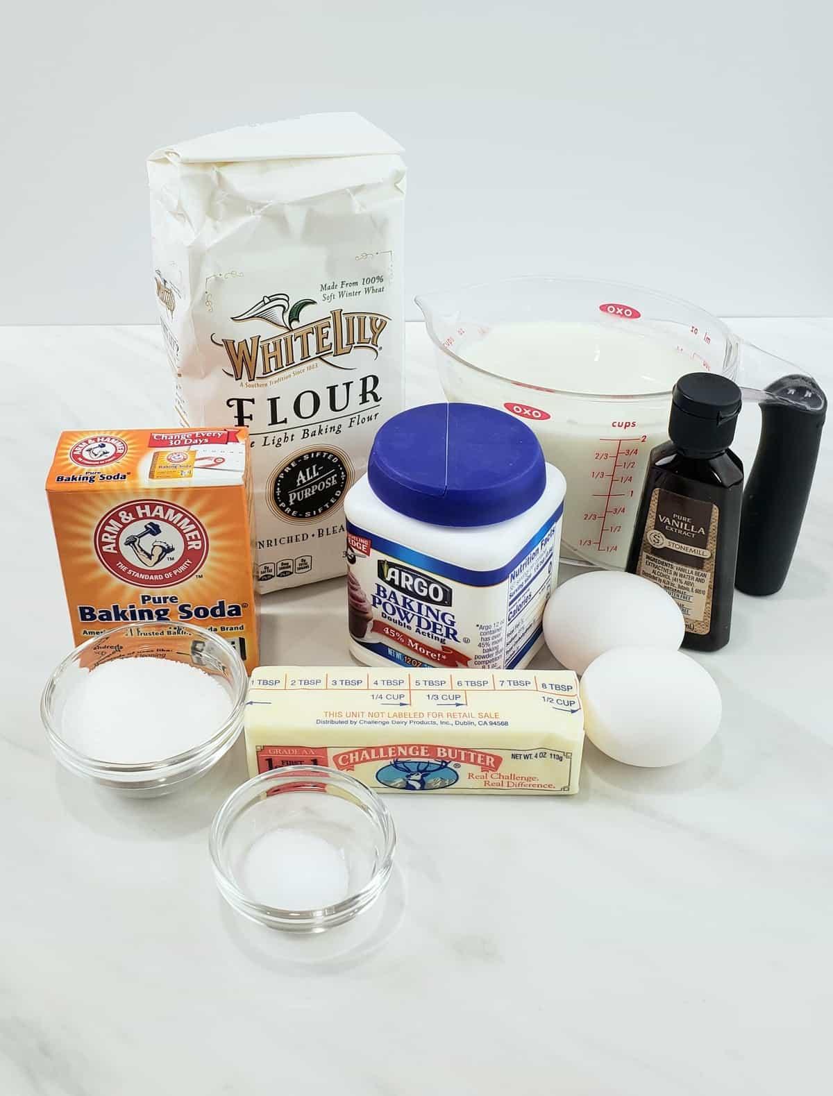 Ingredients: bag of flour, baking soda, butter, vanilla, milk in a measuring cup
