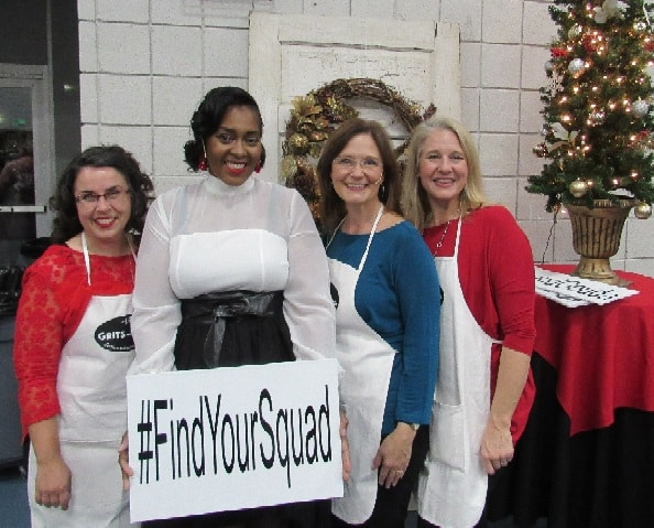Four ladies dressed up for holidays holding a sign#findyoursquad