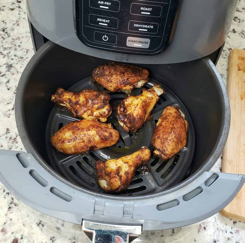 Cooked chicken drums and flats in an open air fryer
